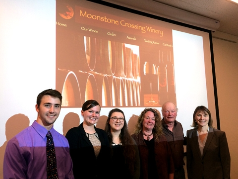 Moonstone Crossing Cancer Research Assistantship award recipients Sharon Otis, Rachel Brewer, and Logan Bailey post with winery owners Don Bremm (M.S. '88, Natural Resources) and Sharon Hanks (B.A. '79), and Amy Sprowles, professor of Biological Sciences.